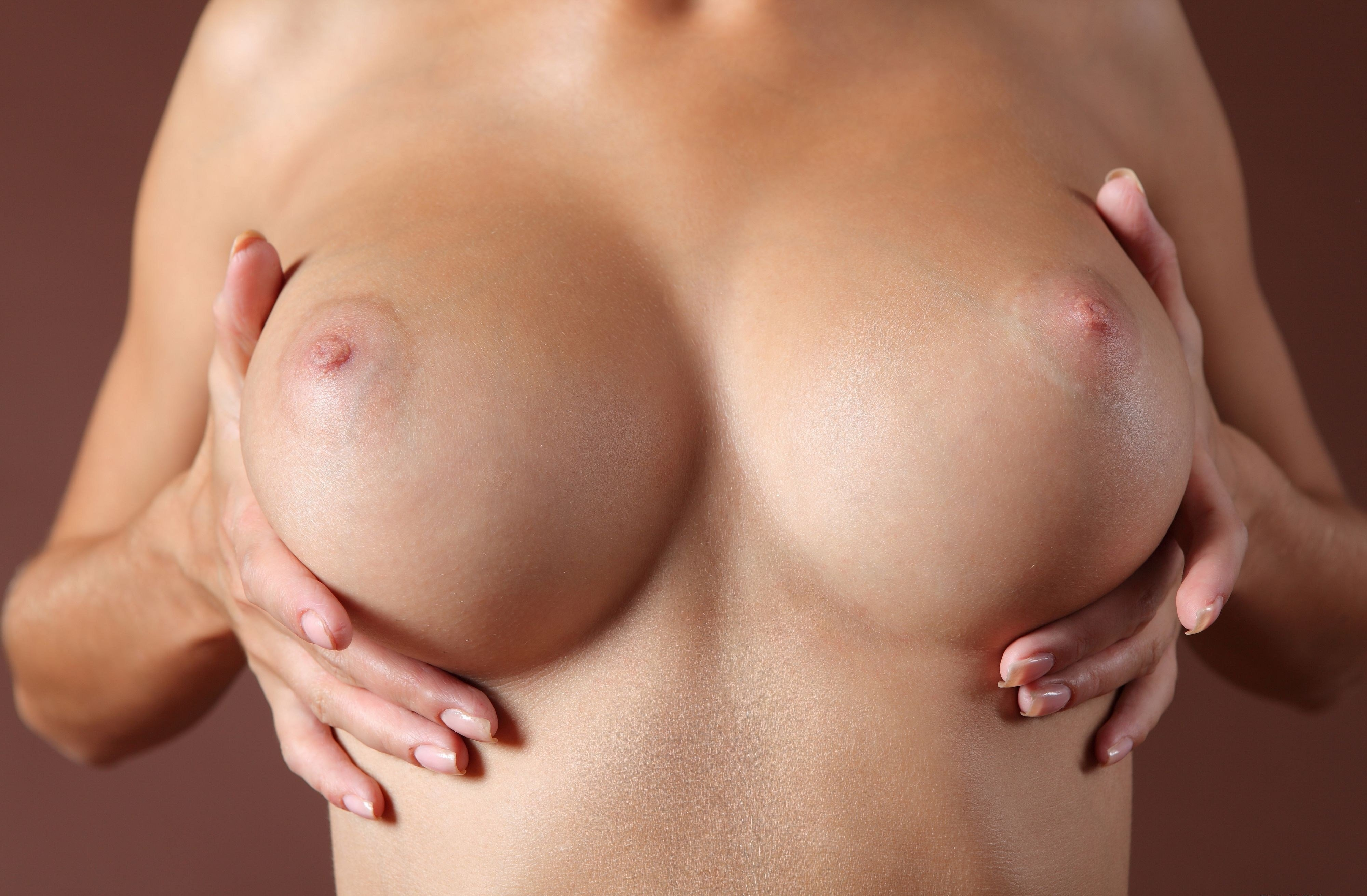 Images of naked breasts